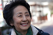 Portrait of Kiyoko Hosokawa campaingning for her husband, the anti-nuclear candidate and former Prime Minister, Morihiro Hosokawa, in the 2014 Tokyo Gubernatorial Elections. Ikebukero, Tokyo, Japan. Friday, February 7th 2014