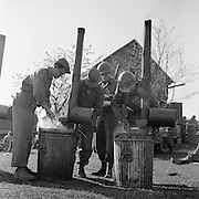 GI's on chow line on the banks of the Danube River, Germany. April 1945
