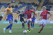 Craig Davies of Mansfield Town (9) battles with Anfernee Dijksteel of Charlton Athletic (2) and George Lapslie of Charlton Athletic (32) during the The FA Cup match between Mansfield Town and Charlton Athletic at the One Call Stadium, Mansfield, England on 11 November 2018.