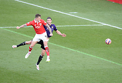 Bristol City's Aden Flint heads towards goal after beating West Ham's Andy Carroll in the air.- Photo mandatory by-line: Alex James/JMP - Mobile: 07966 386802 - 25/01/2015 - SPORT - Football - Bristol - Ashton Gate - Bristol City v West Ham United - FA Cup Fourth Round