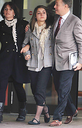 Katherine Goldberg leaving Isleworth Crown Court, West London with her parents, Monday, 28th November 2011 after being  sentenced for groping a male air steward and being drunk on an aircraft .   Photo by:  i-Images