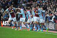 Aston Villa's Gabriel Agbonlahor (11) is congratulated on scoring his sides 1st goal during the Barclays Premier league, Aston Villa v Swansea city at Villa Park in Birmingham, England on Saturday 28th Dec 2013. <br /> pic by Jeff Thomas, Andrew Orchard sports photography.