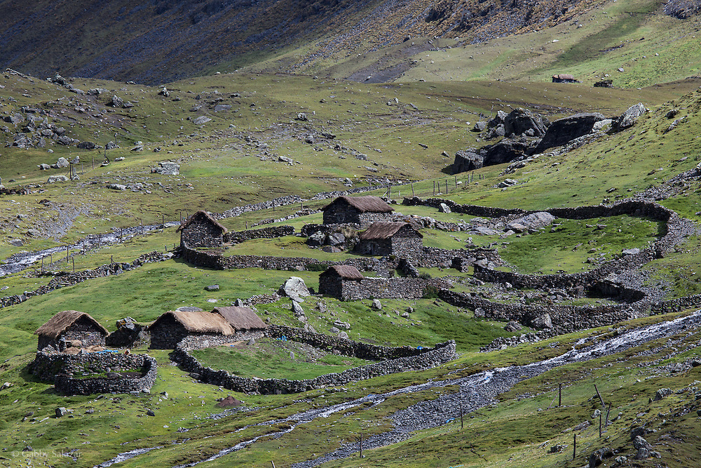 Traditional Andean homestead seen along the Interoceanica Sur highway between Cusco and Puerto Maldonado, Peru. A 430 kilometer section of the transcontinental Interoceanic Highway that crosses Peru and Brazil.