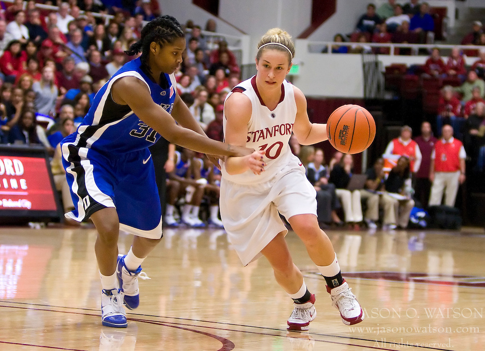 December 15, 2009; Stanford, CA, USA;  Stanford Cardinal guard JJ Hones (10) is guarded by Duke Blue Devils guard/forward Keturah Jackson (31) during the second half at Maples Pavilion.  Stanford defeated Duke 71-55.
