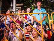 24 JANUARY 2014 - BANGKOK, THAILAND:  Thai anti-government protestors listen to Suthep Thaugsuban at the Shutdown Bangkok Pathum Wan stage. Shutdown Bangkok has been going for 12 days with no resolution in sight. Suthep, the leader of the anti-government protests and the People's Democratic Reform Committee (PDRC), the umbrella organization of the protests,  is still demanding the caretaker government of Prime Minister Yingluck Shinawatra resign, the PM says she won't resign and intends to go ahead with the election.   PHOTO BY JACK KURTZ