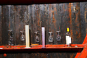 Chateau Pech-Latt. Near Ribaute. Les Corbieres. Languedoc. Wooden fermentation and storage tanks. Measuring cylinder. France. Europe. Bottle. Wine glass.