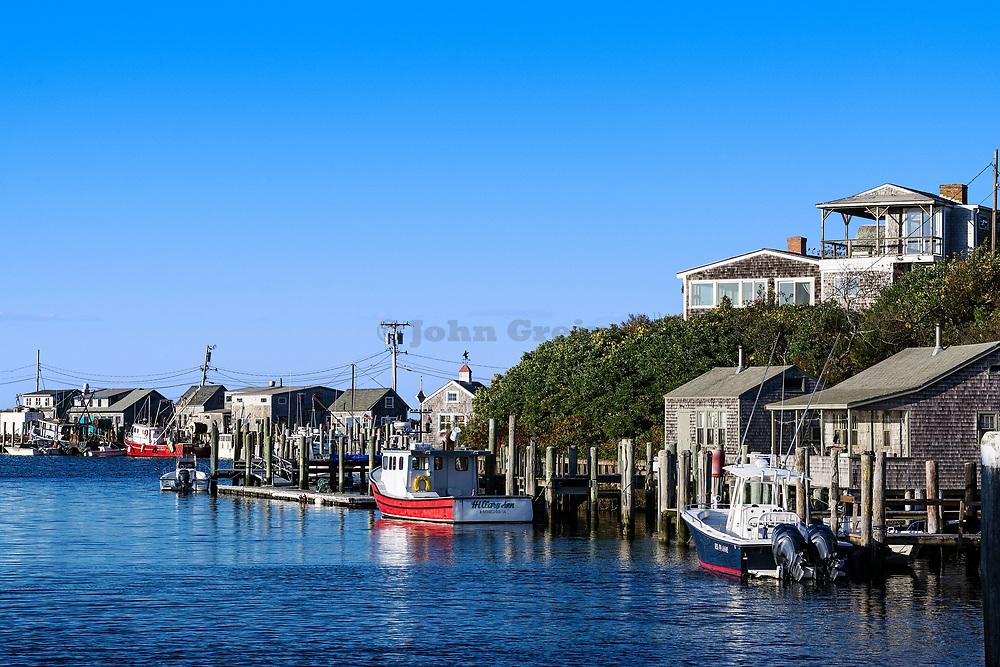 Overview of fishing shacks and boats in the village of Menemsha, Chilmark, Martha's Vineyard, Massachusetts, USA.