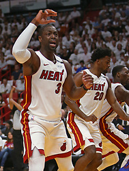 April 19, 2018 - Miami, FL, USA - The Miami Heat's Dwyane Wade reacts after a play during the first quarter against the Philadelphia 76ers in Game 3 of a first-round NBA playoff series at AmericanAirlines Arena in Miami on Thursday, April 19, 2018. (Credit Image: © David Santiago/TNS via ZUMA Wire)