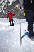 SHOT 3/12/10 2:26:58 PM - Danny Wishard of Sandy, Utah hikes the ridgeline with a group while skiing with friends at Silverton Mountain in Silverton, Co. Silverton Mountain is unique amongst ski resorts requiring a guide (most of the season), avalanche gear and limiting the number of daily visitors. There are multiple bowls, chutes, cliffs and natural terrain features to be discovered during a visit to Silverton Mountain. It is the highest Ski Area in North America with a peak of 13,487' and it is also the steepest with no easy way down. The mountain is left in it's natural state with the exception of the avalanche reduction work which occurs. There is only one chair at the mountain though most skiiers and snowboarders will end up hiking in various directions at the top. The mountain also features heliskiing trips for $159 a trip (at the time of visit). The mountain opened in 2002. (Photo by Marc Piscotty / © 2010)