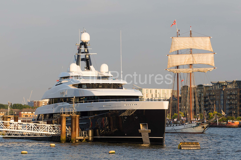 A tall ship sails past the brand new 74.5m long superyacht, Elandess, seen moored at HMS President on the River Thames on July 05, 2018 after making its maiden voyage to London this week. Elandess was built at the Abeking and Rasmussen shipyard in Germany for owner, Lloyd Dorfman, the founder of Travelex, was launched in May 2018 and has just completed sea trials ahead of its London visit. Elandess has an axe-bow, dark hull and low-slung superstructure. There are a variety of entertaining communal spaces, from the 8 x 2.5-metre superyacht swimming poollocated on the massive sun deckto the Nemo Loungewith portholesbelow the waterline and an observation lounge on the upper deck. Guest accommodation includes six staterooms, including the master suitewhich is placed forward on the main deck with an observation lounge directly above on the upper deck.