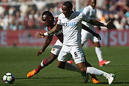 Leroy Fer of Swansea City (R) is fouled by Michail Antonio of West Ham United (L). Premier league match, West Ham Utd v Swansea city at the London Stadium, Queen Elizabeth Olympic Park in London on Saturday 8th April 2017.<br /> pic by Steffan Bowen, Andrew Orchard sports photography.