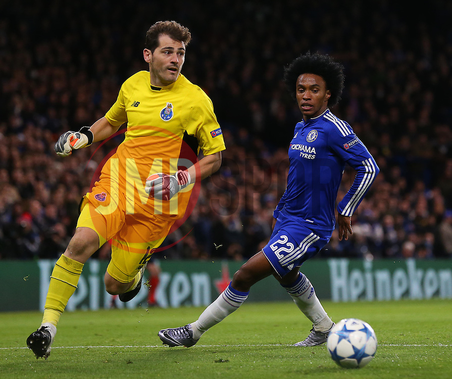 Iker Casillas of FC Porto controls the ball ahead of Willian of Chelsea - Mandatory byline: Paul Terry/JMP - 09/12/2015 - Football - Stamford Bridge - London, England - Chelsea v FC Porto - Champions League - Group G