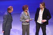 Jubileumviering van 15 jaar VandenEnde Foundation en 5 jaar DeLaMar.<br /> <br /> Op de foto:  Janine van den Ende geeft het eerrste fotoboek aan Jasper Krabbe met links fotograaf Koos Breukel