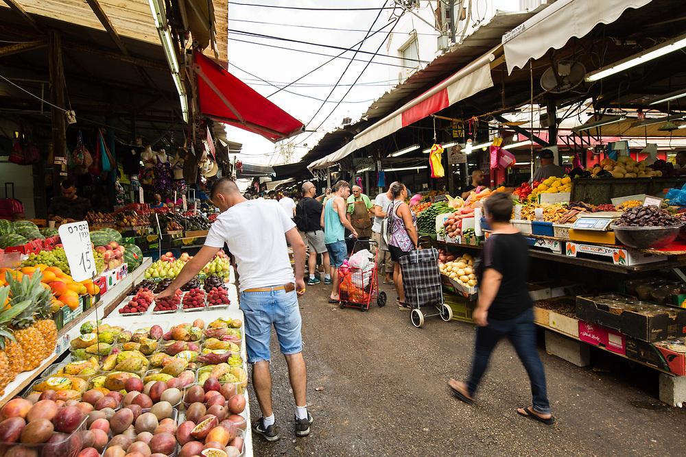 People are seen shopping in Shuk HaCarmel (HaCarmel Market), located next to Kerem Hateimanim neighborhood of Tel Aviv, Israel