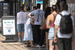 © Licensed to London News Pictures. 19/07/2021. London, UK. People queue outside a pharmacists to receive the Covid 19 vaccination on Freedom Day marking the final government Covid 19 lifting of restrictions. Photo credit: Ray Tang/LNP