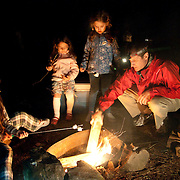 Roasting marshmallows on a campfire at Tulley Lake Campground, Royalston, Massachusetts