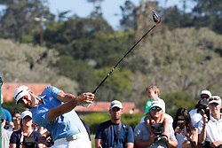 June 11, 2019 - Pebble Beach, CA, U.S. - PEBBLE BEACH, CA - JUNE 11: PGA golfer Dustin Johnson tees off on the 10th hole during a practice round for the 2019 US Open on June 11, 2019, at Pebble Beach Golf Links in Pebble Beach, CA. (Photo by Brian Spurlock/Icon Sportswire) (Credit Image: © Brian Spurlock/Icon SMI via ZUMA Press)