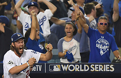 October 25, 2017 - Los Angeles, California, U.S. - Los Angeles Dodgers' Clayton Kershaw reacts as teammate Logan Forsythe (not pictured) scores on a single Enrique Hernandez (not pictured) against the Houston Astros in the tenth inning of game two of a World Series baseall game at Dodger Stadium on Wednesday, Oct. 25, 2017 in Los Angeles. Houston Astros won 7-6 in 11 innings. (Photo by Keith Birmingham, Pasadena Star-News/SCNG) (Credit Image: © San Gabriel Valley Tribune via ZUMA Wire)