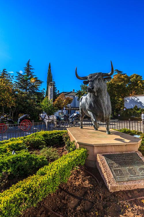 The sculpture of a bull in Blas Infante Gardens, Ronda, Spain.