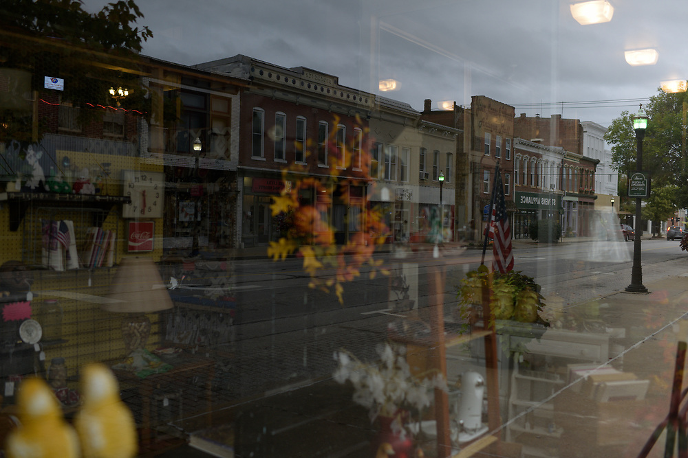 Boonville's Main Street is reflected in a storefront window. Taken as part of the 71st Missouri Photo Workshop in Boonville, Mo.