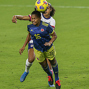 ORLANDO, FL - JANUARY 22:  Jorelyn Carabali #16 of Columbia heads the ball away from Margaret Purce #23 of United States at Exploria Stadium on January 22, 2021 in Orlando, Florida. (Photo by Alex Menendez/Getty Images) *** Local Caption *** Jorelyn Carabali; Margaret Purce