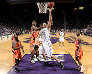 Feb 09, 2008; Manhattan, KS, USA; Kansas State Wildcats forward Michael Beasley (30) drives to the basket and scores against the Oklahoma State Cowboys in the first half at Bramlage Coliseum in Manhattan, KS. Mandatory Credit: Peter G. Aiken-US PRESSWIRE