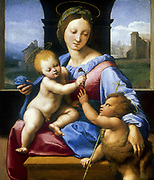Madonna and Child with the Infant Baptist (The Garvagh Madonna) 1509-1510, depicting the moment when Christ takes the carnation from John the Baptist's Hand. Raphael (1483-1520) Raffaello Santi, Italian painter.  Oil on Wood.