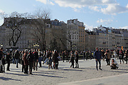 Crowds of people visit Notre Dame in Paris each day and stop to have their photos taken in front of it.