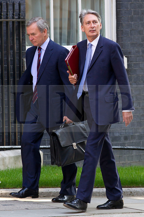 "© Licensed to London News Pictures. 29/08/2013. London, UK. The Defence Secretary Philip Hammond (R) and Chief of Defence Staff General Sir John Nicholas Reynolds Houghton arrive for a meeting of the British cabinet on Downing Street in London today (29/08/2013) as a recalled British Parliament prepares to debate the possibility of ""direct"" military action over recent reports an alleged chemical weapons attack in Syria. Photo credit: Matt Cetti-Roberts/LNP"