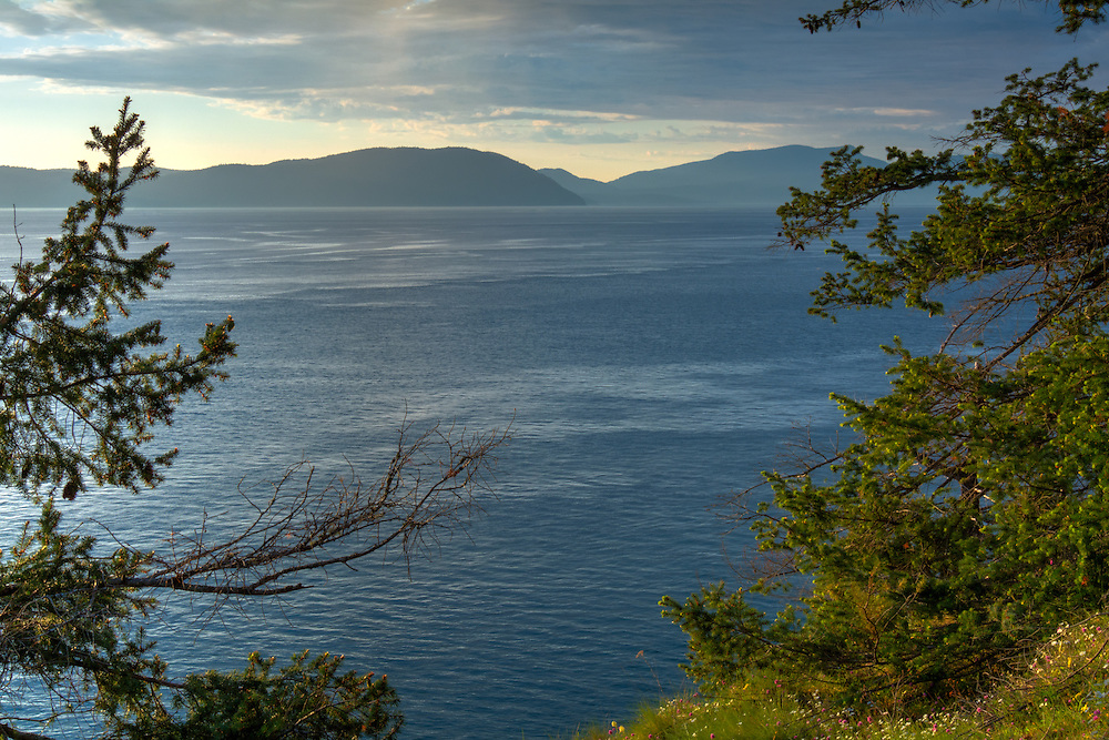 One of the many intensely beautiful coastal locations of the Pacific Northwest, the waters around the San Juan and Orcas Islands look like nowhere else in North America.  This view overlooks Rosario Strait from Washington's Fidalgo Island.