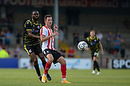 Tom Hopper (11) of Lincoln City Scunthorpe United Emannuel Onariase (6) battles for possession during the Pre-Season Friendly match between Scunthorpe United and Lincoln City at the Sands Venue Stadium, Scunthorpe, England on 27 July 2021.