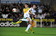 Swansea City's Alvaro Vazquez back heels the ball.<br /> UEFA Europa league match, Swansea city v FC Kuban Krasnodar at the Liberty Stadium in Swansea, South Wales on Thursday 24th October 2013. pic by Phil Rees, Andrew Orchard sports photography,
