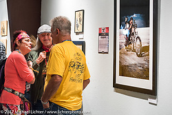 Diva Amy talking with Pat Simmons and Clyde Fessler at the Old Iron - Young Blood exhibition media and industry reception in the Motorcycles as Art gallery at the Buffalo Chip during the annual Sturgis Black Hills Motorcycle Rally. Sturgis, SD. USA. Sunday August 6, 2017. Photography ©2017 Michael Lichter.