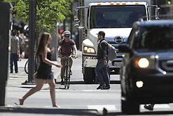 June 14, 2018 - TORONTO, ON - June 14: Pedestrians, cyclists and vehicles all navigating along Queen Street. June 14, 2018. Randy Risling/Toronto Star (Credit Image: © Randy Risling/The Toronto Star via ZUMA Wire)