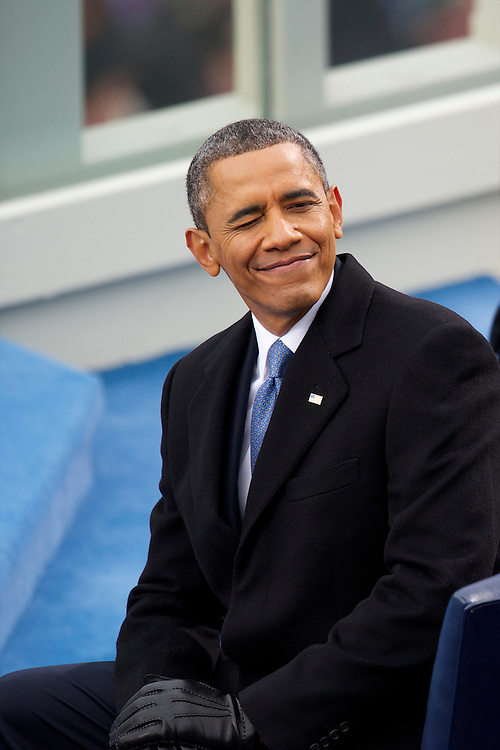President Barack Obama winks to attendees during the 57th Inauguration in Washington D.C., on January 20. 2013.