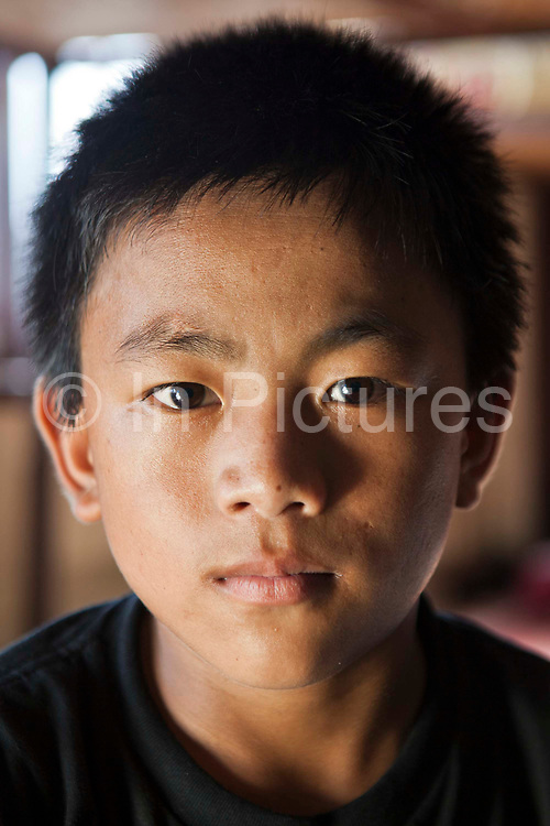 A young Nepalese orphan in the Voice of Children rehabilitation center in Kathmandu, Nepal. The not-for-profit organisation supports street children and those who are at risk of sexual abuse through educational and vocational training opportunities, health services and psychosocial counseling. This boy also lives in the center while he is part of the rehabilitation program and hopes to be fostered.