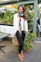 OLIVIA COLE at a party to celebrate 'A Year In The Garden' celebrating the first year of The Ivy Chelsea Garden, 197 King's Road, London on 16th May 2016.