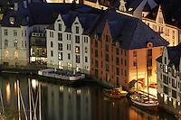 Ålesund 20050513. Hus ved Brosundet / Ålesundet i Ålesund. Til venstre i bildet er en lekter for uteservering om sommeren.<br /> <br /> Art Nouveau houses next to Brosundet / Aalesundet in Aalesund city.<br /> <br /> Foto: Svein Ove Ekornesvåg