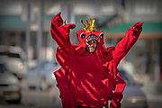 Travis Rigby promotes a golden king crab sale on Monday, March 23, 2021 in Ketchikan, Alaska. The crew of the fishing vessel Confidence provided a dockside sale and pickup of live golden king crab nearby at Casey Moran Float.