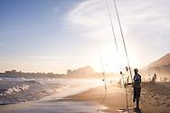 Fishing at Copacabana Beach at Sunset