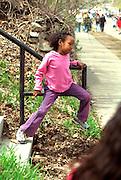 Girl age 5 leaning on railing at Cinco de Mayo Festival.  St Paul Minnesota USA