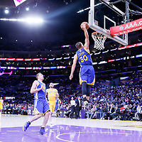 11 April 2014: Golden State Warriors guard Stephen Curry (30) goes for the dunk during the Golden State Warriors 112-95 victory over the Los Angeles Lakers at the Staples Center, Los Angeles, California, USA.