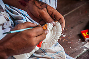 Sculptor working in Kumartuli potters quarter, Kolkata, India