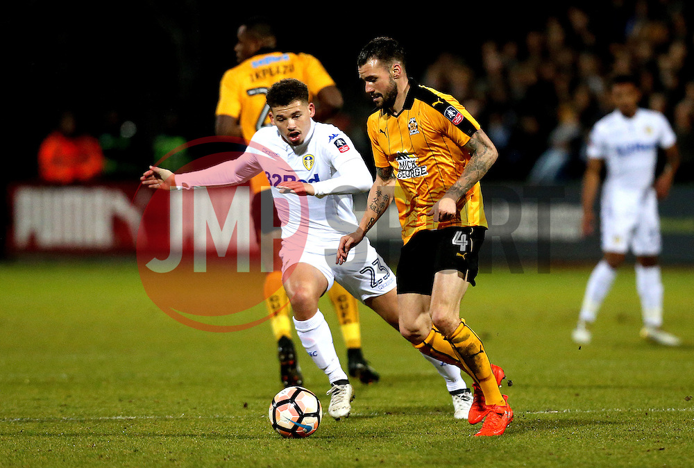 James Dunne of Cambridge United goes past Kalvin Phillips of Leeds United - Mandatory by-line: Robbie Stephenson/JMP - 09/01/2017 - FOOTBALL - Cambs Glass Stadium - Cambridge, England - Cambridge United v Leeds United - FA Cup third round