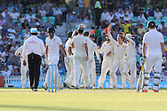Australia celebrate the wicket of Captain Alastair Cook of England during the third day of the 5th Investec Ashes Test match between England and Australia at The Oval, London, United Kingdom on 22 August 2015. Photo by Ellie Hoad.