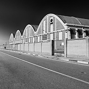 Porto Marghera, Italy Veneto, 2020: Industrial sheds at docklands in Porto Marghera.. Signed and editioned prints available at 50x40cm. Get and touch, for commercial uses or other sizes. Photographs by Alejandro Sala