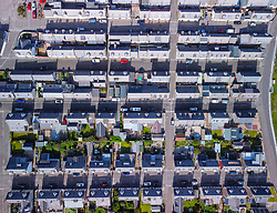 Aerial view from drone of rows of houses in former fishing village of Portknockie on Moray Firth coast in Moray, Scotland, UK