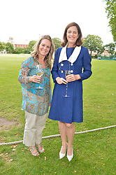 Left to right, TRACEY COX and MINNIE CECIL at the Flannels for Heroes Cricket tournament in association with Dockers in aid of the charities Walking With The Wounded, On Course Foundation and Combat Stress held at Burton Court, London on 20th June 2014.