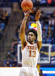 Feb 9, 2019; Morgantown, WV, USA; Texas Longhorns guard Jase Febres (13) shoots a three pointer during the first half against the West Virginia Mountaineers at WVU Coliseum. Mandatory Credit: Ben Queen-USA TODAY Sports