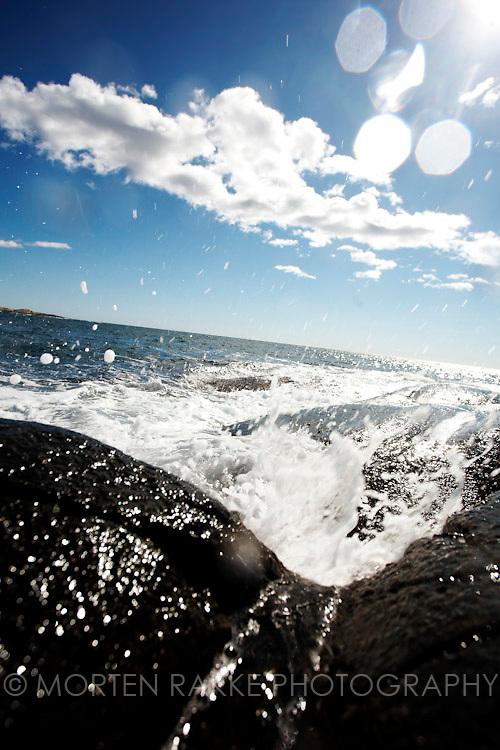 Rakke, Norway. Water splashing on rocks, close-up